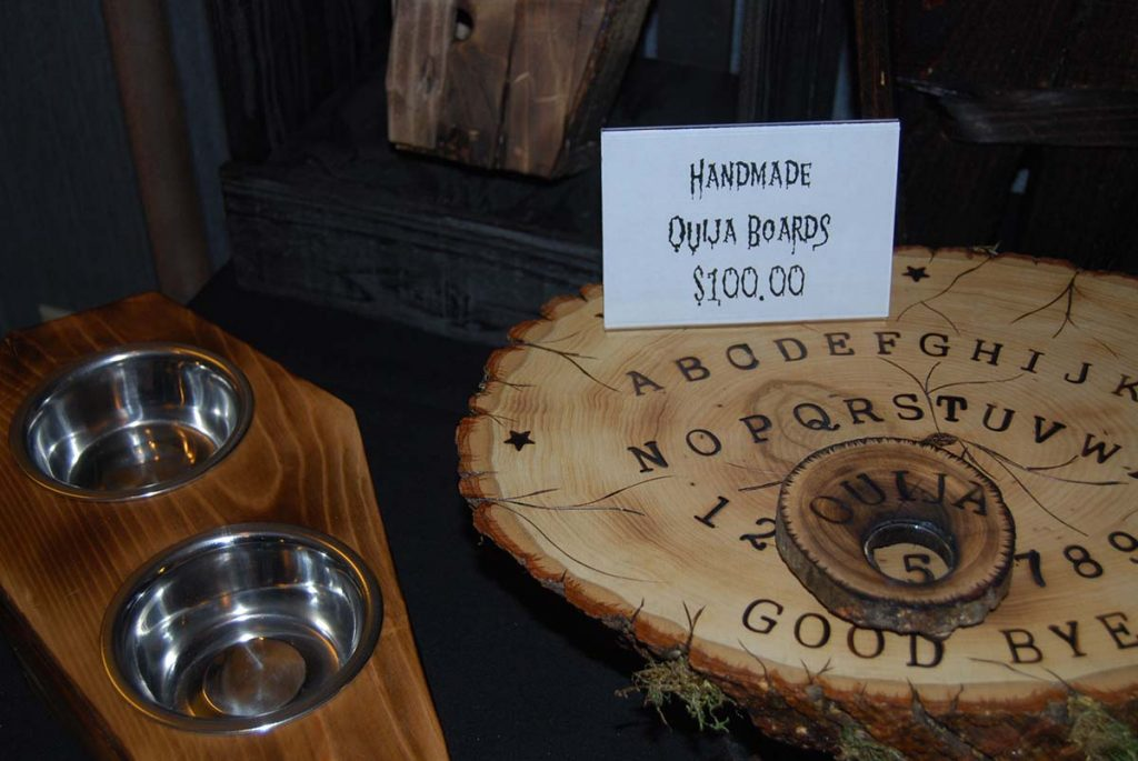 Handmade ouija board and coffin-themed pet dishes