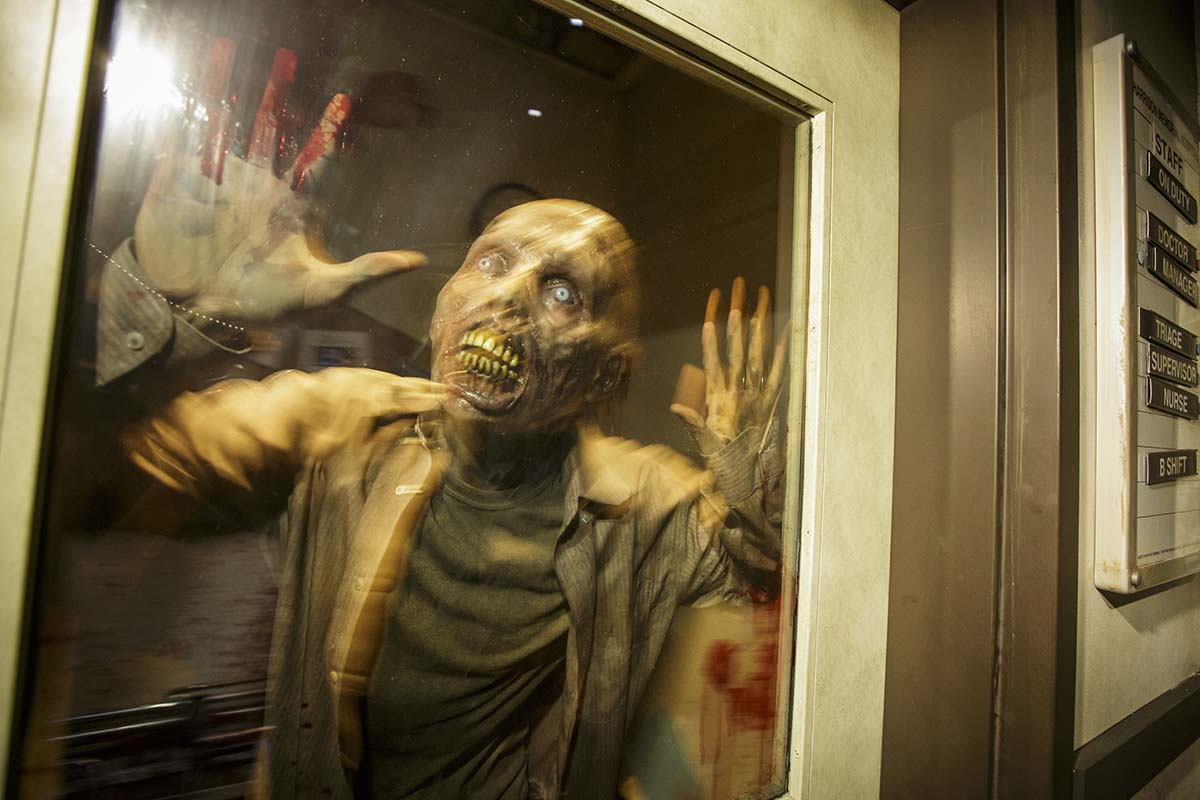 "Zombie poses for picture at ""The Walking Dead"" permanent attraction/Photo by David Sprague"