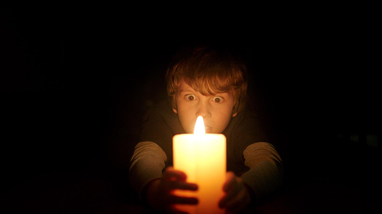 "Gabriel Bateman as Martin in New Line Cinema's horror film ""Lights Out,"" a Warner Bros. Pictures release. / Photo Credit: Courtesy of Warner Bros. Pictures / Copyright: © 2016 WARNER BROS. ENTERTAINMENT INC. AND RATPAC-DUNE ENTERTAINMENT LLC ALL RIGHTS RESERVED"