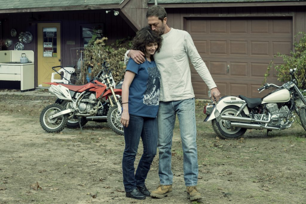 "Ebon Moss-Bachrach as Chris McQueen, Ashleigh Cummings as Vic McQueen in ""NOS4A2"""